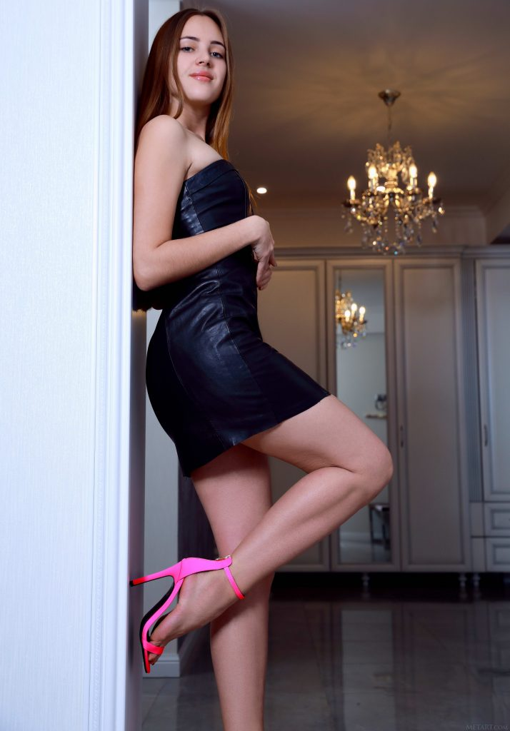 Teen In High Heels And Black Dress